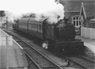 A historical photo of a Strawberry Line train pulling into Sandford station